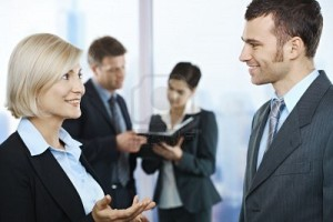 6578880-standing-business-people-talking-in-office-smiling-at-each-other-coworkers-looking-at-documents-in-b-300x200.jpg