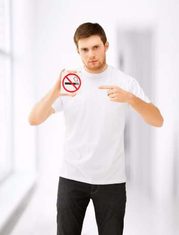 young-man-pointing-at-no-smoking-sign.jpg