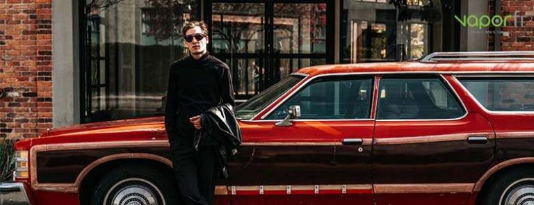 vaper standing in front of car