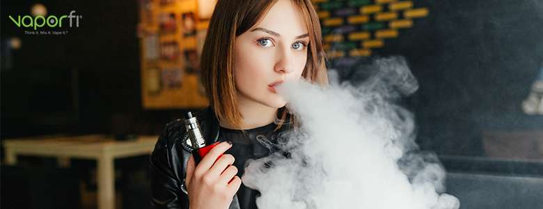 woman with red mod blowing e-juice cloud
